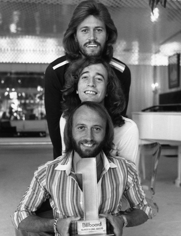 The Bee Gees, from top to bottom, Barry, Robin and Maurice Gibb